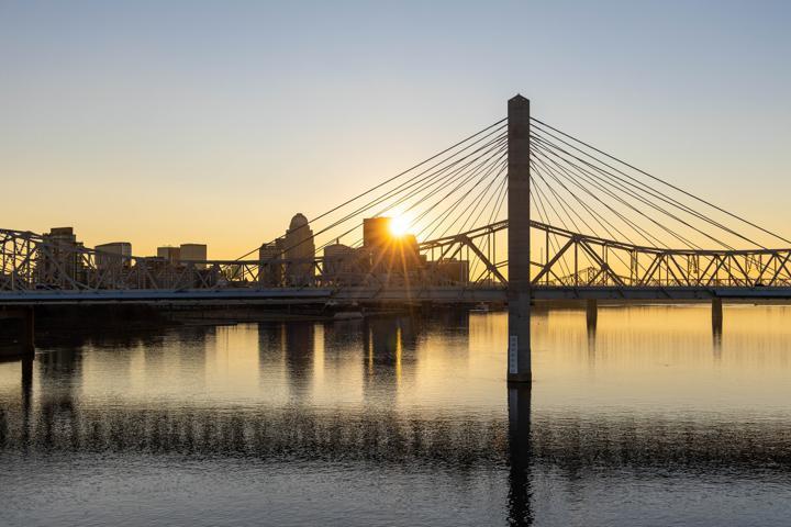 bridge over water during sunset