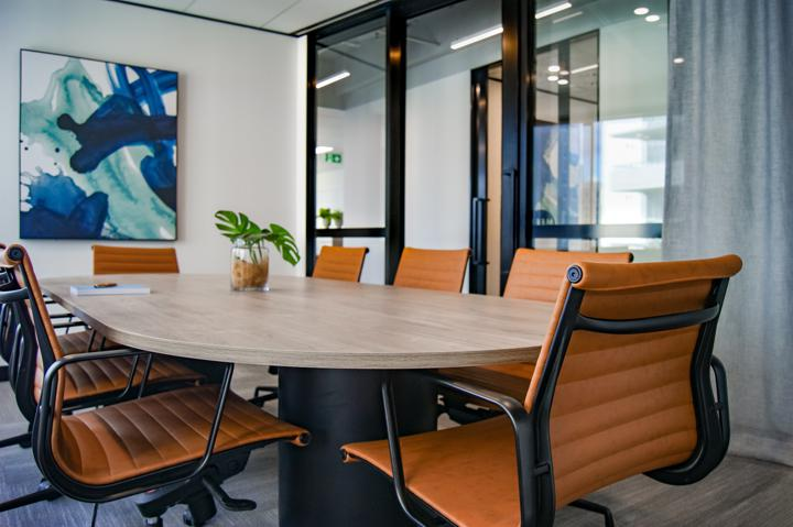 brown wooden 9-piece office table and chairs blog