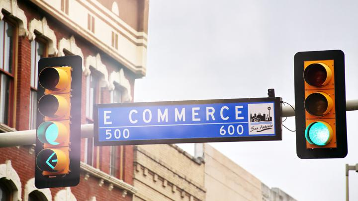 Ecommerce street sign next to stop light