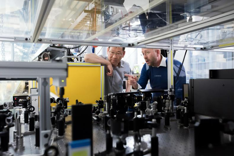 NetSuite Work Orders and Assemblies -men inside manufacturing building