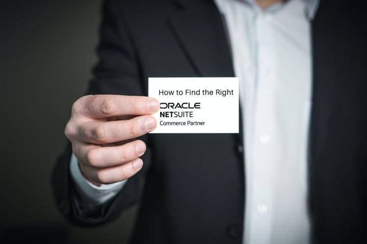 Man holding NetSuite business card
