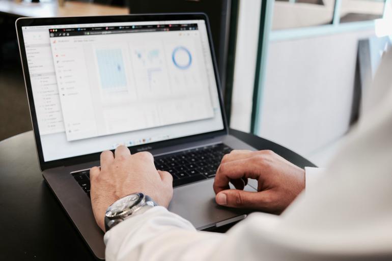 NetSuite Data Center - person using MacBook Pro