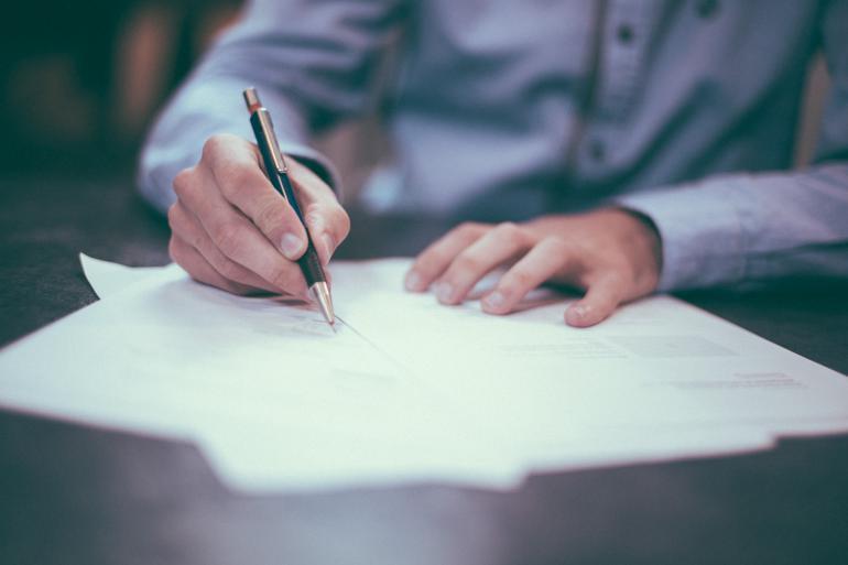 NetSuite Advanced Financials man writing on paper