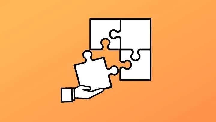white puzzle pieces on orange background