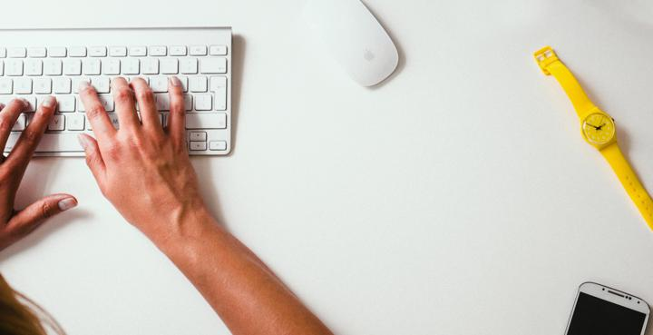 person typing on Apple Cordless Keyboard blog