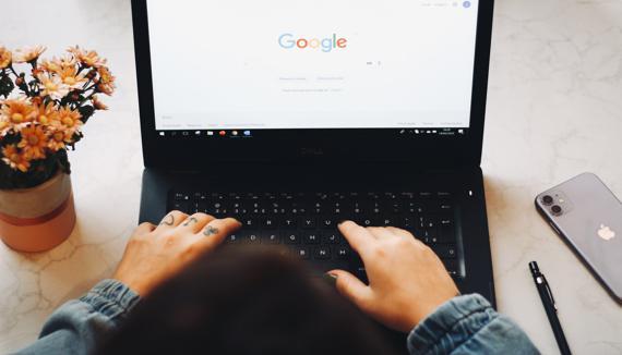 person using black laptop computer best erp software