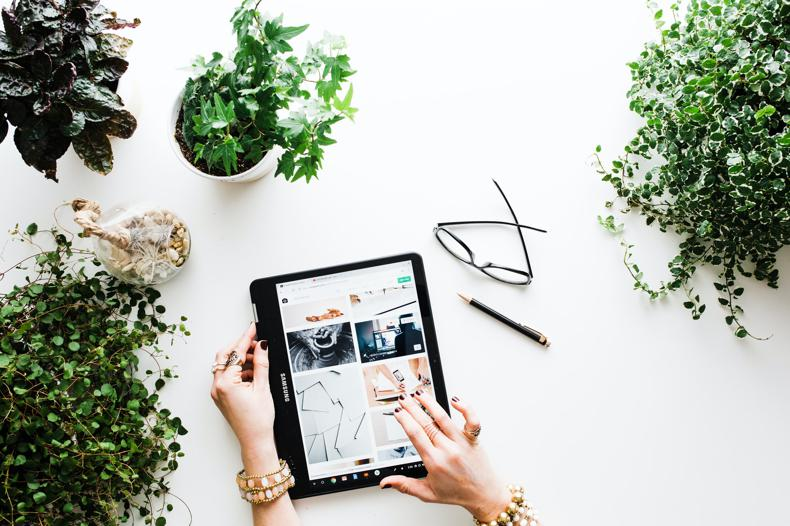 NetSuite SuiteCommerce InStore person using black tablet computer