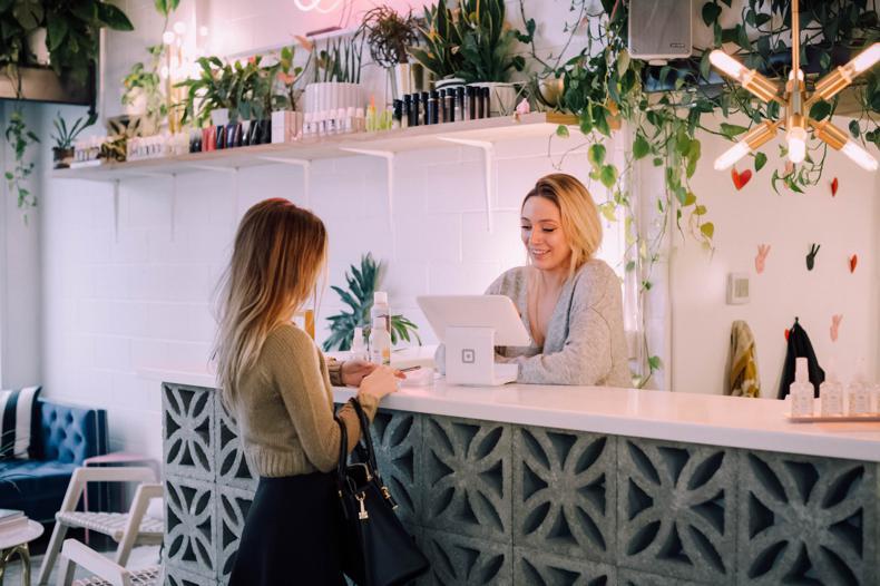NetSuite Bronto Marketing Platform -woman facing on white counter