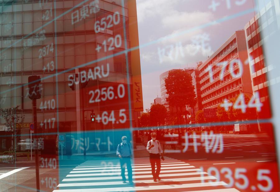 Markets slide after Wall St tech rout