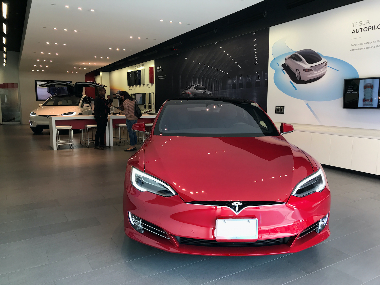 Tesla charges more as share price sparks into life again