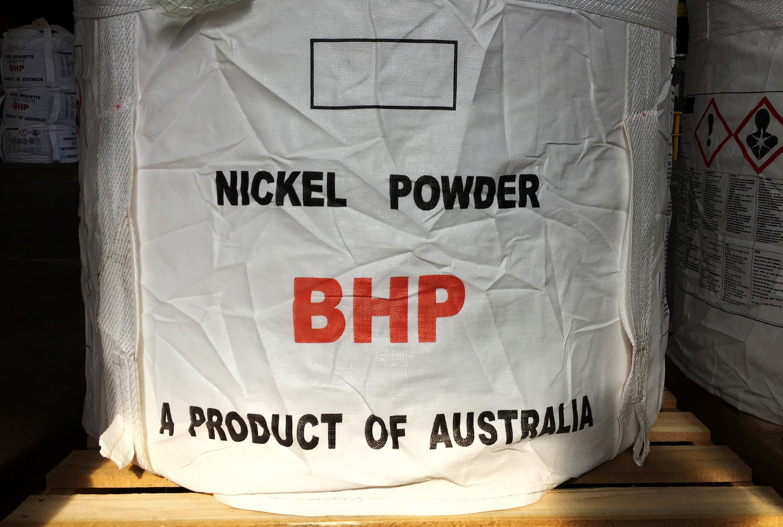 BHP signals shift away from coal as profits dip
