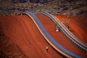 BHP bulks up its half-year dividend as demand for iron ore soars