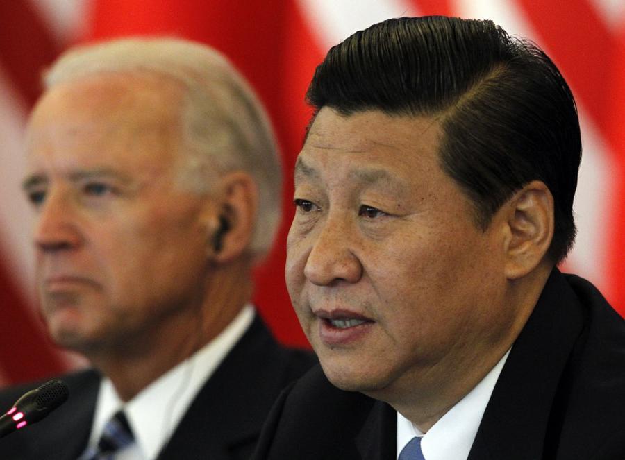 Biden warns Xi on Hong Kong, Uighurs