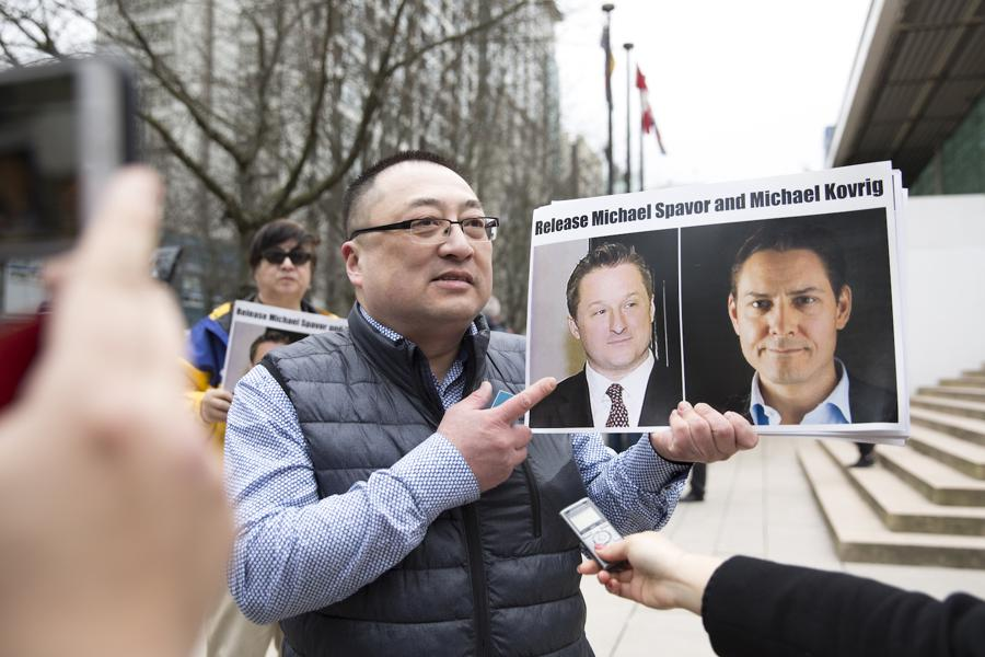 China suspends visits to detained Canadian pair