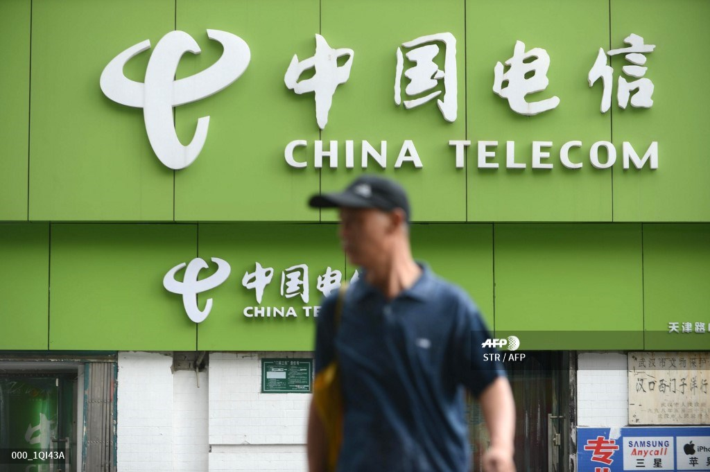 China's telecoms big three see shares plunge over NYSE delisting move