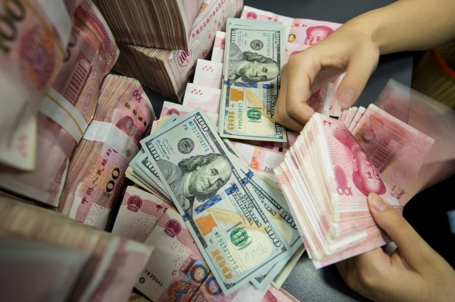 As US Fed buys everything, US dollar down, yuan up