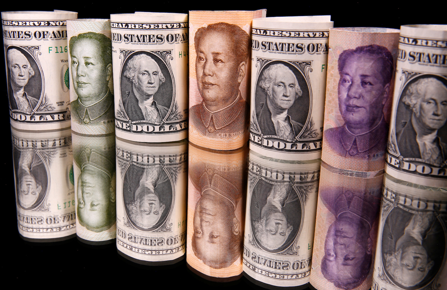Yuan fights back as IMF shows 26% drop in US dollar holdings