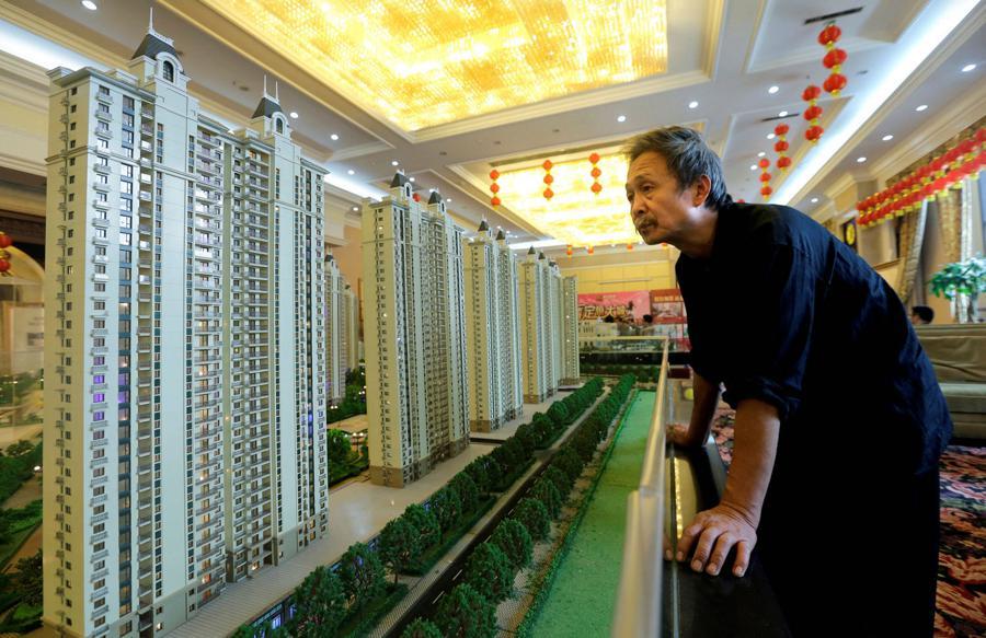 Evergrande Property Services fades on debut amid concerns over debt