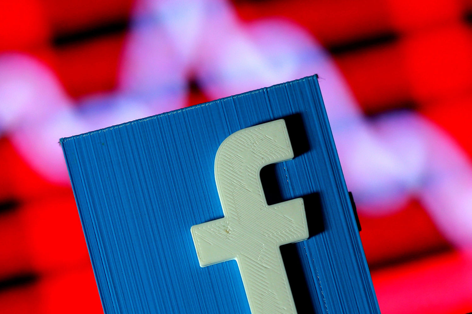 Facebook ratchets up fight with Australia over news payments