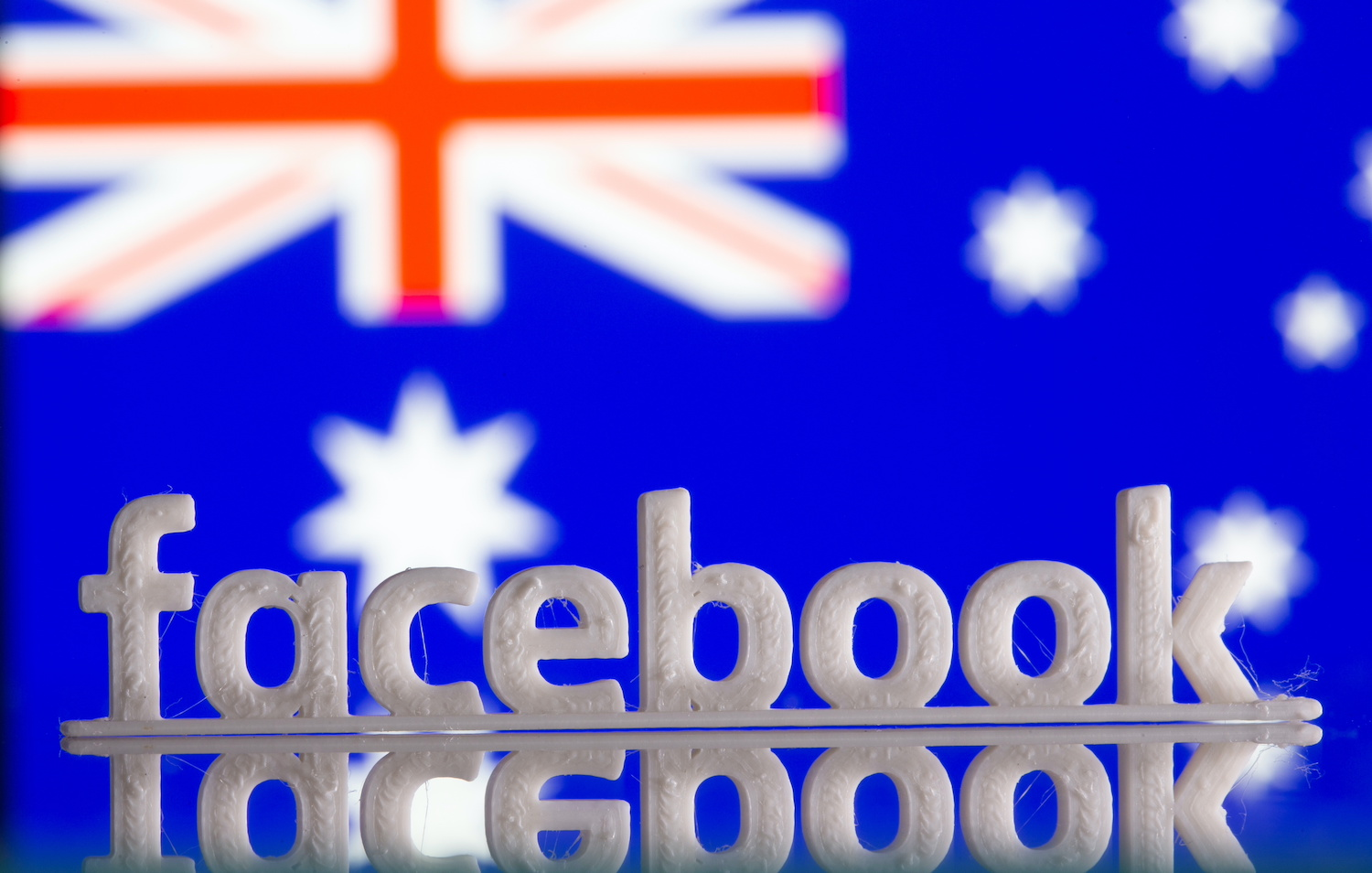 Facebook to restore news pages after deal with Australian govt