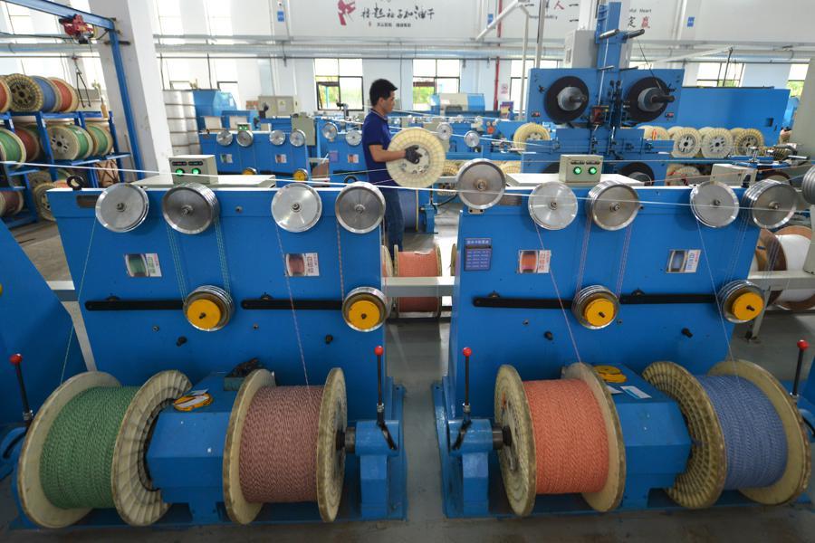 China's factory output hits 3-year high, November PMI data show