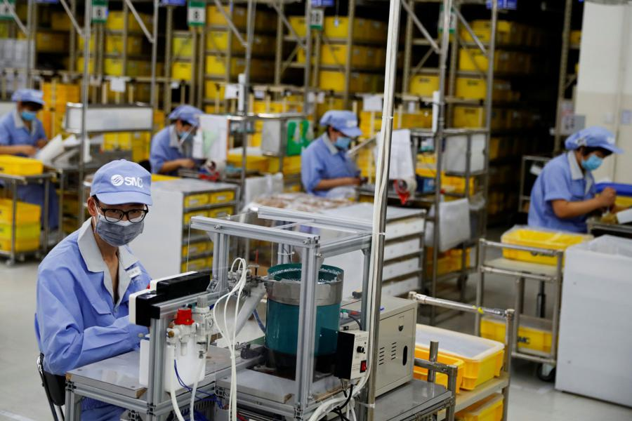 China factory output rises 7% as economy shakes off pandemic
