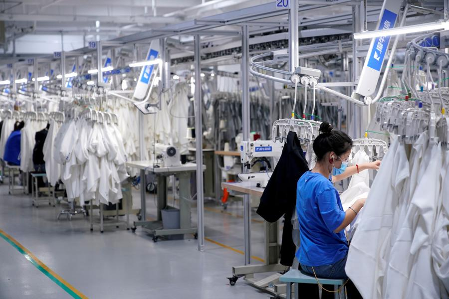 China's factory gate prices fall at slowest pace since February