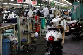 Japan manufacturers' optimism hits two-year high on strong demand
