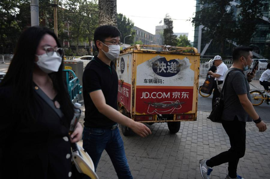 JD.com prices HK shares as US-listed Chinese firms look homeward