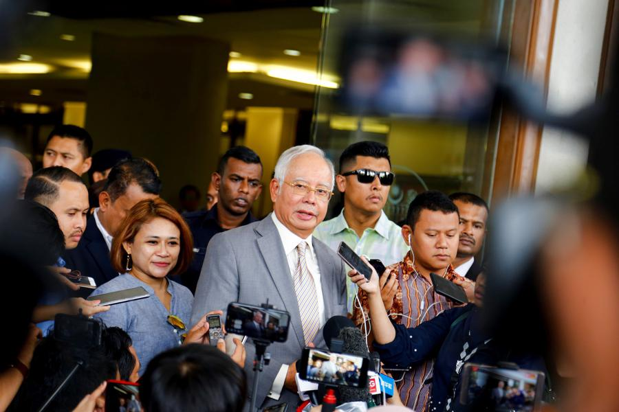 Najib gets 12 years jail for corruption in first 1MDB trial