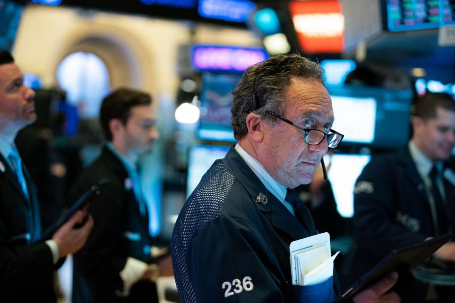 US stocks end down after volatile session, weak data