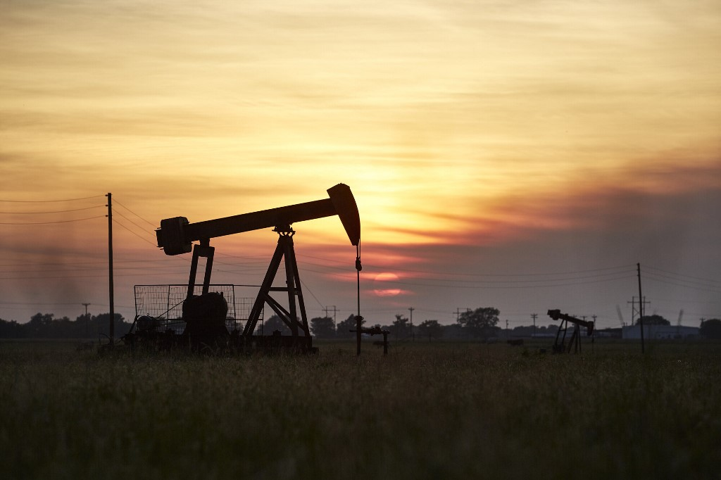 Crude extends rally as output cuts begin