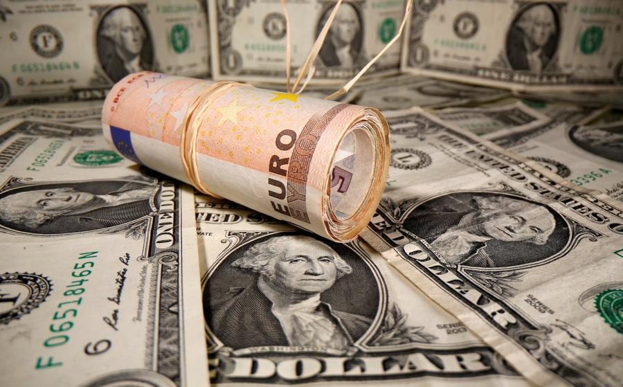 US dollar skids from four-week high, euro gains
