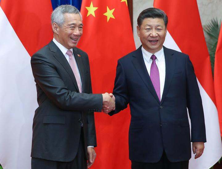Singaporean Prime Minister Lee Hsien Loong met with Chinese President Xi Jinping and other senior Chinese leaders during a three-day official visit to Beijing that began Sept. 19. The visit is seen as a bid by China to improve relations with the island city-state. Photo: AFP/ Lintao Zhang