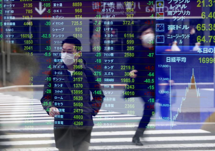 Asian shares slip as economic strains pile up