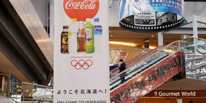 Japan PM says Olympics will go on despite surge in coronavirus