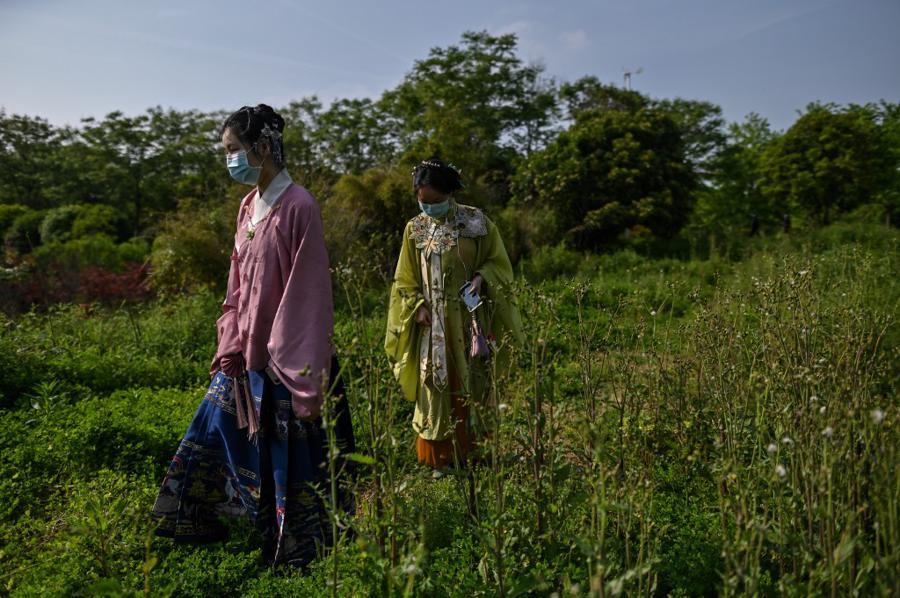 Flickers of joy in Wuhan mask deep fears