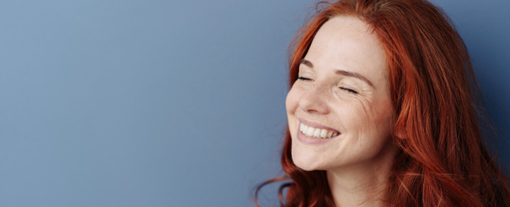 Smiling girl with red hair - serotonin