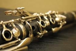 shallow focus photography of black and silver clarinet