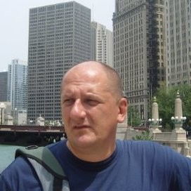 a bald man in the city