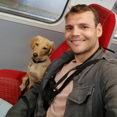Nico with a puppy on the train