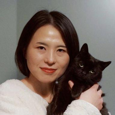 Qian holding a black cat
