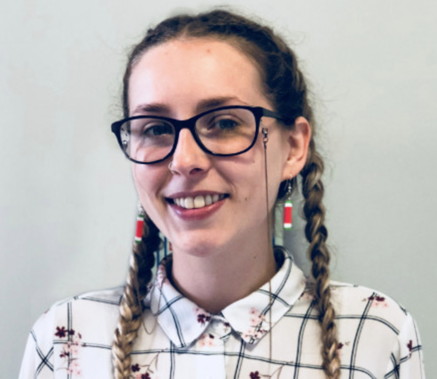 a smiley woman with glasses and braids