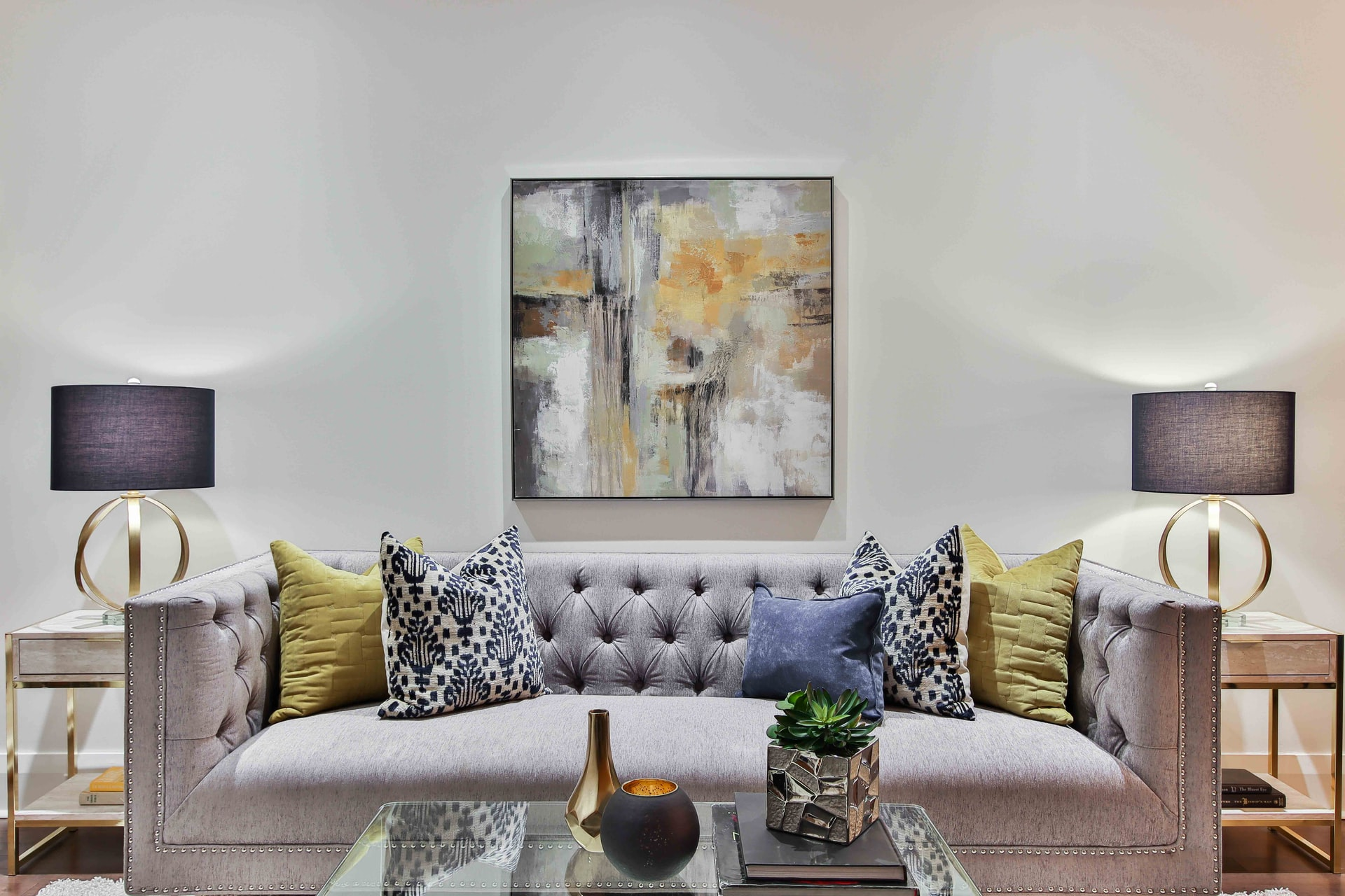 white and blue floral throw pillows on white couch