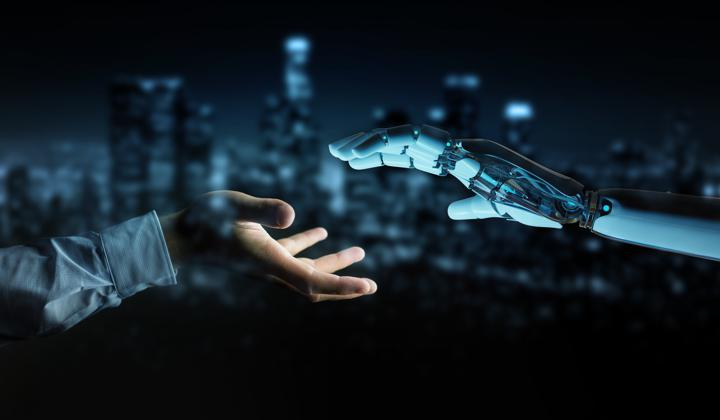 Image of human and robot hand joining together