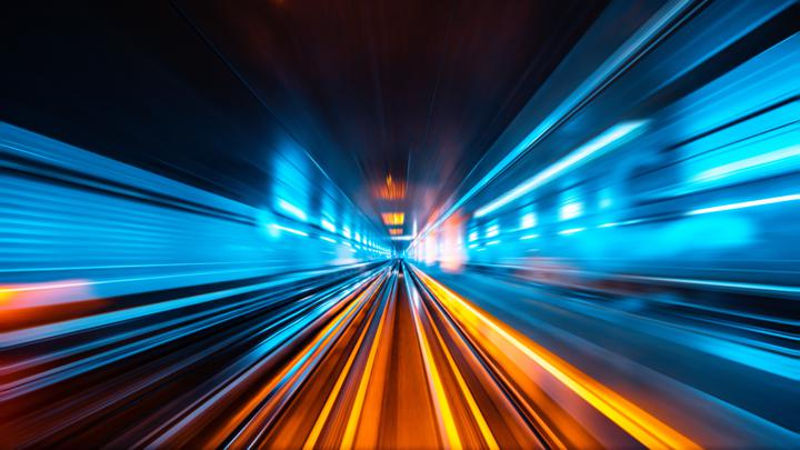 Photograph of fast moving lights in tunnel