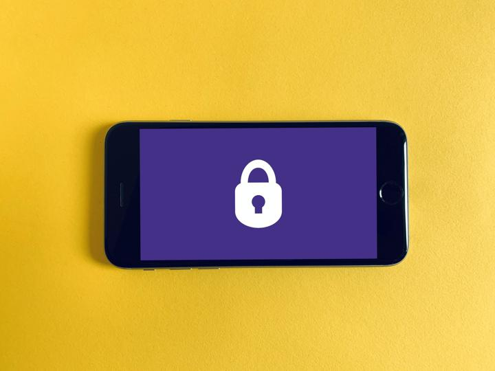 cell phone laying horizontally with a lock on the screen