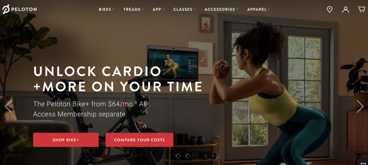 Peloton's website hero section showing a person working out using their product and links to shop their products or compare costs