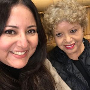Caregiver taking a smiling selfie with her mom
