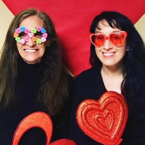 Caregiver smiling with heartglasses with her mother